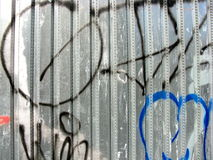 Graffiti on metal fence. Abstract graffiti on a metal fence Royalty Free Stock Photography
