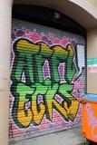 Graffiti on Metal Shutters Royalty Free Stock Photo