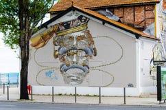 Graffiti mit einem Mann, der grüßt Stockbild