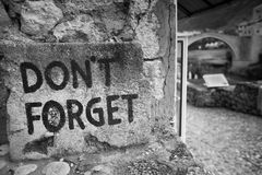Graffiti in Mostar, Bosnia and Herzegovina. Graffiti that reads Don't Forget is on a ruined wall in the city of Mostar in Bosnia and Herzegovina.  It is Stock Images