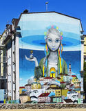 Graffiti, mural, Moore's 'Revival' on the facade of the five-story building. Andrew's descent city Kyiv. Ukraine royalty free illustration