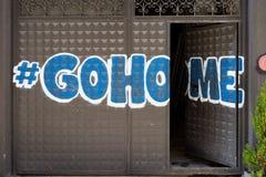 Graffiti na bramie Gohome Zdjęcia Royalty Free