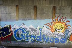Graffiti of the name Girdwood. Spray painted under a bridge name of small town in alaska stock photography