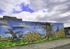 Graffiti in New York City against a blue sky. Graffiti in New York City has had a country-wide and perhaps even international influence. Originating in the New Royalty Free Stock Photography