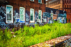 Graffiti on an old brick building, seen from the Reading Viaduct Royalty Free Stock Photos