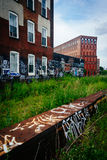Graffiti on an old brick building, seen from the Reading Viaduct Stock Photos