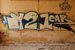 Graffiti Old Brick wall background. Old Brick dilapidated wall background with graffiti stock photography