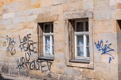 Graffiti on an old historic sandstone facade. Love - Peace - Harmonie Royalty Free Stock Photo