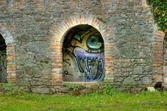Graffiti on the old paper mill - Tiffauges Stock Image