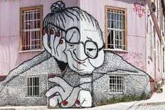 Graffiti old woman facade valparaiso stock image