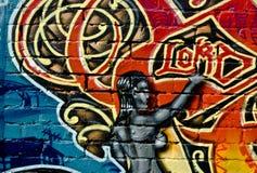 Graffiti op de geweven bakstenen muur Stock Foto
