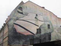 Graffiti op de muur van een huis in Riga royalty-vrije stock afbeelding