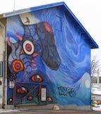 Graffiti op de muur van het inbouwen van Rovaniemi, Finland Stock Foto's