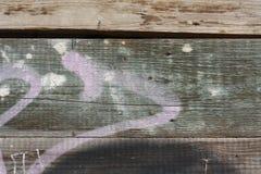 Graffiti op een houten muur Stock Foto