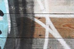 Graffiti op een houten muur Stock Foto's