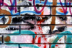 Graffiti op een muur - het detail van een graffiti schilderde op een muur Royalty-vrije Stock Afbeeldingen