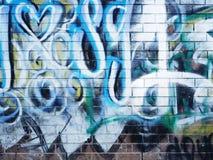 Graffiti op een stedelijke bakstenen muur in Glen Waverley Stock Foto