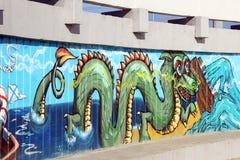 Graffiti op het muurbeeld van een draak Royalty-vrije Stock Afbeeldingen