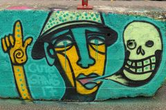 Graffiti, op weg concret blokken stock foto