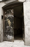 Graffiti in an open rusted door Royalty Free Stock Images