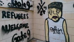 Graffiti over vluchtelingen in Nicosia Stock Afbeelding