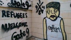 Graffiti over vluchtelingen in Nicosia stock afbeelding