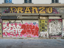 Graffiti overwhelms old restaurant storefront in Paris Stock Photography