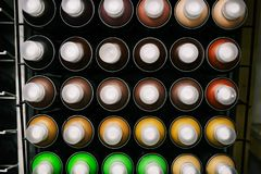 Graffiti paint cans in the store. Sales of paint for drawing on the walls or the creation of creativity. New cans of paint in. Different colors royalty free stock photos
