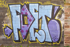 Graffiti painted. On a brick wall Stock Image