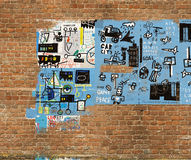Graffiti. Is painted on the wall of red brick Royalty Free Stock Photography