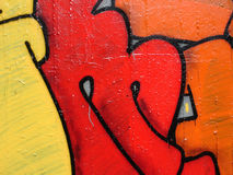 Graffiti painting. Closeup of a wall with lettering Royalty Free Stock Photo
