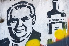 Graffiti painting of Miloš Zeman and Becherovka bottle. Prague, Czech Republic - July 3, 2017: Political graffiti painting on the wall at the outskirts of royalty free stock photography