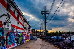 Graffiti and parked cars in an alley at sunset in Baltimore, Mar royalty free stock photos