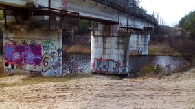 Graffiti on the piers of the bridge Royalty Free Stock Images