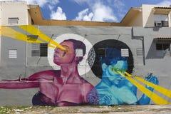 Graffiti of pink woman and blue woman beaming light. Royalty Free Stock Photo