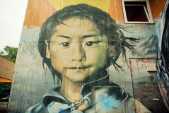 Graffiti with poor girl face, Royalty Free Stock Images