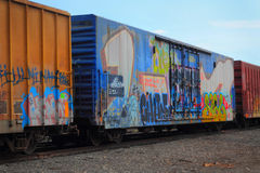 Graffiti on railroad cars stock photos