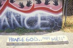 Graffiti reading �Praise God not men�, South Central Los Angeles, California Stock Photo