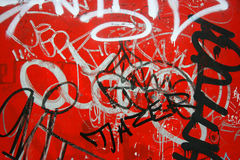 Graffiti on red, horizontal Stock Image