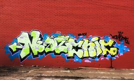 Graffiti in Red Wall. Urban Art in City. Visual Art. Graffiti is writing or drawings made on a wall or other surface, usually without permission and within royalty free stock photos