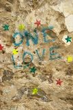 Graffiti on rock wall. Stock Photo