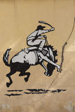 Graffiti of rodeo, man riding horse. Old Wall, Argentina royalty free stock images