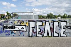 Graffiti on a scateboard rink with the slogan Ukraine Peace. Stock Photos