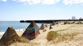 Graffiti sculpture on the beach. In Badalona, Barcelona Royalty Free Stock Images