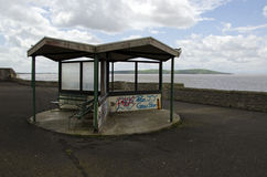 Graffiti on seafront seating. Royalty Free Stock Images