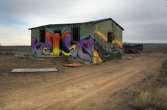 Graffiti shack. Old western structure covered with graffiti Royalty Free Stock Image