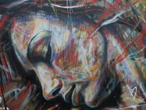 Graffiti depicting a female face. Graffiti showing the face of a sleeping young woman in close-up Royalty Free Stock Photo
