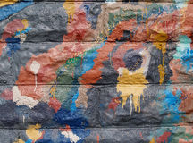 Graffiti on the Side of  a Public Building. Colorful graffiti texture on the side of a public building in a variety of colors Royalty Free Stock Photo