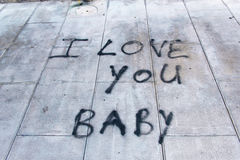 Graffiti on sidewalk I love you baby Royalty Free Stock Images