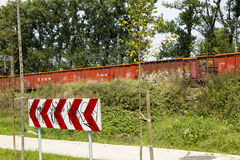 Graffiti on the sign and the train Stock Photo